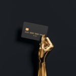 guy with gold hand holding credit card
